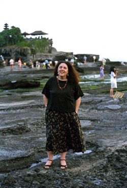 Ann Dunham visiting the rocky Balinese seacoast at Tanah Lot.
